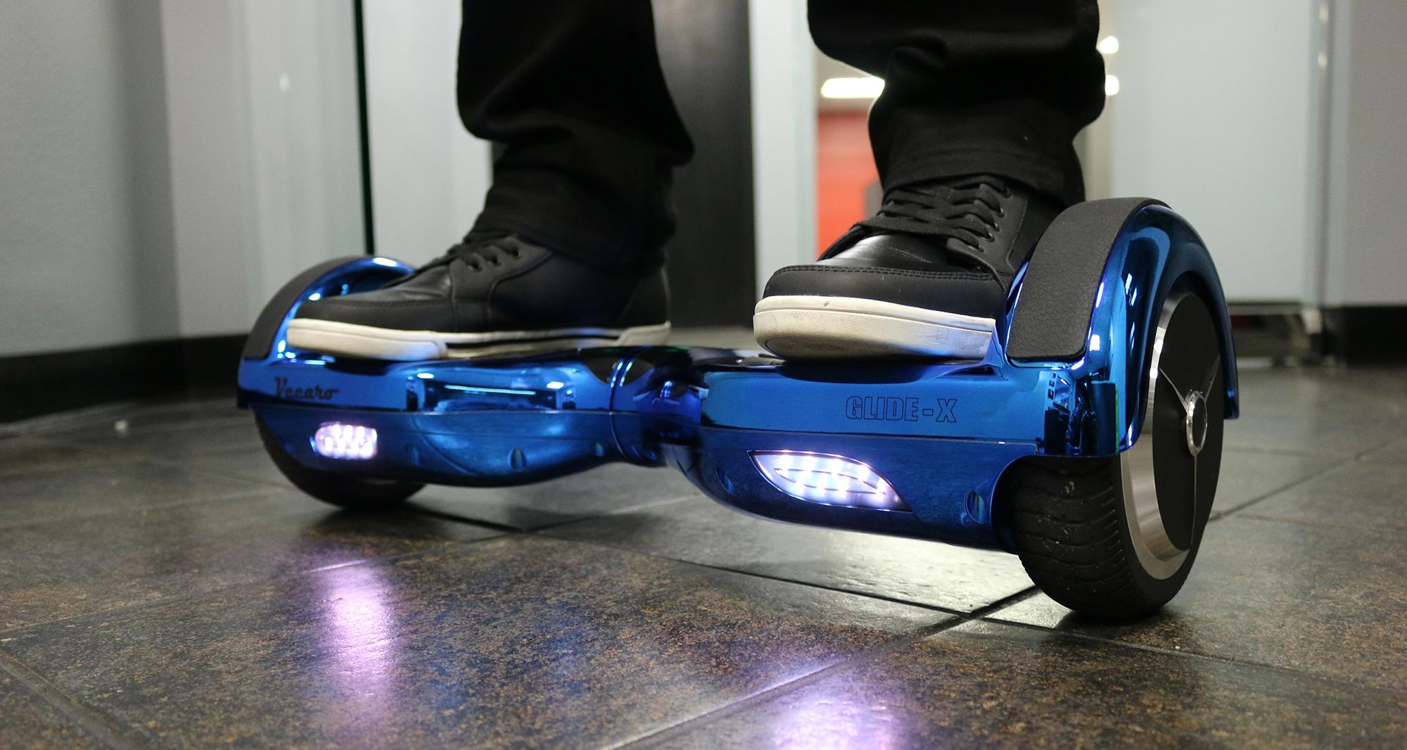 Riding Vecaro Glide-X hoverboard